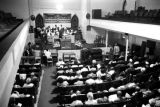 Man speaking to an audience in a church building, probably in Birmingham, Alabama.