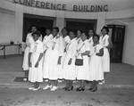 Group photograph of members of the Order of the Eastern Star standing in front of conference building