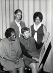 Inez Jackson and three other women looking at a poster board