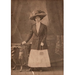 An African-American woman wearing an ornate hat.
