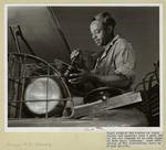 Thumbnail for Negro Soldier Who Serves As Truck Driver And Mechanic Does A Good Job On The Air Cleaner Of An Army Truck At Fort Knox, Kentucky, June, 1942