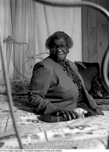 Osceola Mays seated on her bed Dallas/Fort Worth Black Living Legends Dallas/Fort Worth Black Living Legends, 1991