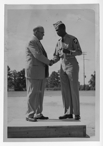 Photograph of Commissioner Alcorn welcoming home Sergeant Albert Dixon, Manchester, Georgia, 1953