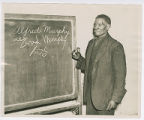 Former slave in literacy class