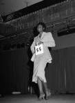 Black Gold Trade Show Pageant participant modeling, Los Angeles, 1983