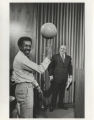 Richard J. Daley with man spinning basketball at City Hall