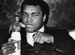 Ali poses with replica