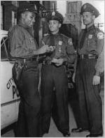 Boxhead Turner (left), Clarence Perry (center), and Claude E. Mundy, Atlanta, Georgia police officers in 1950s photograph. Mundy was the first Atlanta African American police officer to be killed in the line of duty (January 5, 1961).