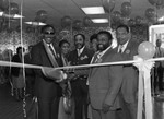 Chicken George ribbon cutting participants posing together, Los Angeles, 1985