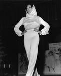 Ebony Fashion Fair model posing on a runway