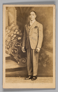Photographic postcard of an unidentified man in a suit