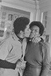 George Jackson kissing black woman on the cheek, San Quentin Prison