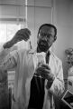 Agricultural scientist holding test tubes in a laboratory at Tuskegee Institute in Tuskegee, Alabama.