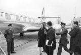 Marie Reeb (Mrs. James Reeb) talking to an NBC reporter while walking toward an airplane.