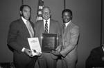 Black Enterprise Magazine luncheon participants holding awards, Los Angeles, 1987