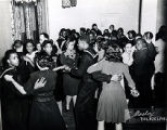 Servicemen dance the jitterbug at the Christian Street YMCA during World War II