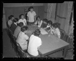 Group of eleven members of the Japanese YMCA holding meeting in Los Angeles, Calif. , circa 1941
