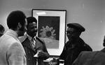 Jesse Fuller speaking with tv host and newsman Ray Taliaferro (left) and unidentified man after his concert at the Oakland Museum