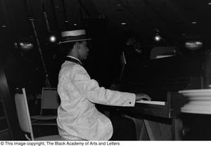 Photograph of an unidentified man playing the piano Jack Evans Breakfast with JBAAL