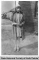 Era Bell Thompson in dress and heels, Bismarck, N.D.