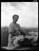 Woman washing near home of negro; on way to San Luis