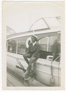 Digital image of a woman in front of a boat on Martha's Vineyard