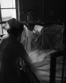 Nurse at the bedside of a polio victim in a tent