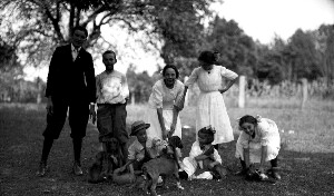 Unidentified group of children with dogs.