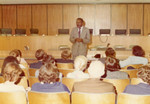 An African American man lecturing