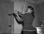 Young woman playing violin : cellulose acetate photonegative]
