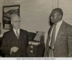Silas Hunt with Frederick Kerr, University of Arkansas Registrar