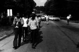 Edward Rudolph leading marchers down a paved road in Prattville, Alabama, during a demonstration sponsored by the Autauga County Improvement Association.