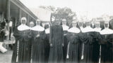 Group Portrait of Father Martin, S.V.D., and Sisters of the Holy Family, Christ the King Mission, Grand Coteau (Bellevue), Louisiana, 1941