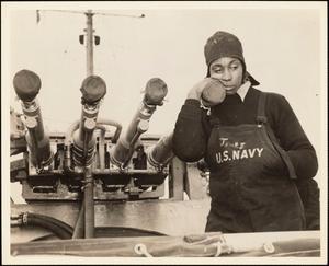 Sailor James Posing with Guns of USS Mason (DE-529), Spectacle Island, Boston, Massachusetts
