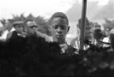 Boy viewing Martin Luther King, Jr.'s casket at South View Cemetery.