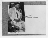 """Mississippi State Sovereignty Commission photograph of Bill Bailey pinned to a piece of paper that reads """"[reporter] State Times"""", Jackson, Mississippi, 1950s"""