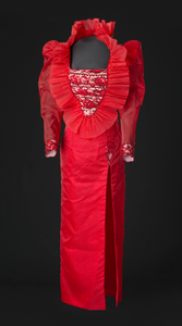 Red dress with ruffled collar designed by Peter Davy