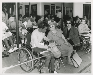 Women in wheelchairs eating lunch