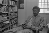John Blassingame: New York. John Blassingame seated in office, Fredrick Douglas portrait on the wall (BLJP 1-79 #101)