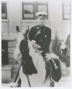 """Abilene Police Chief William R. """"Ruck"""" Sibley Riding a Horse"""