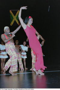 Dancers performing onstage during Ashe Caribbean event Ashe Caribbean Dance
