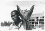 [An African American man with a shovel.]