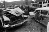 Damaged cars in the street after the bombing of 16th Street Baptist Church in Birmingham, Alabama.