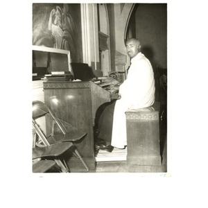 Laymon Hunter sits at the organ.