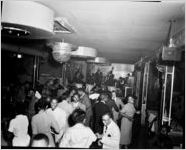 African-Americans on dance-floor, band in the background, at the 180 Club, Atlanta, Georgia Party sponsored by Davison-Paxon, December 3, 1953
