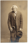 Thumbnail for Man in suit, with hat and cane, ca. 1912