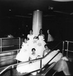 Women in formal attire posing on stairway