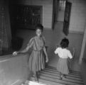 Susie Sanders and Shirley Martin walking down the stairs at Sidney Lanier High School in Montgomery, Alabama.