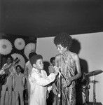 Diana Ross talking with Michael Jackson on stage, Los Angeles, 1969