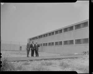 J. David White, George F. McGrath, and Warden John Gavin standing outside of the Walpole Prison
